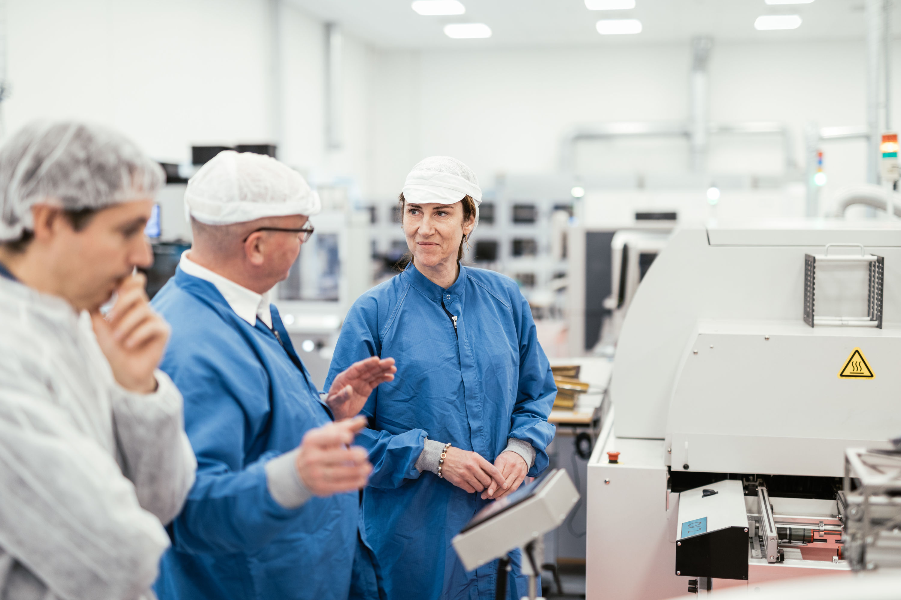 Morten Andersen, VP, Component Manufacturing, explains to Gitte Aabo, CEO, GN Hearing, the processes involved in manufacturing hearing aid chips and plastics at GN Hearing's facility in Præstø